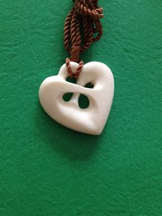 RVShack - Hand carved Bone necklaces Wood Carvings - on Etsy. Very sweet small carved heart - nice work.