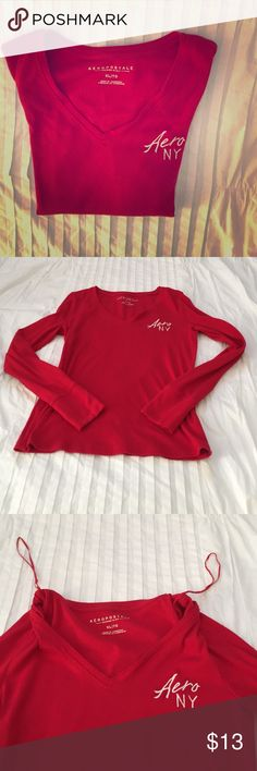 Woman's Red Aeropostale Long Sleeve Shirt I bought this shirt washed it once and never wore it so it's pretty much brand new! There are no tears, holes or stains. It has the strings inside the shirt to be able to hang it up on a hanger It says XL but fits more like a large. It is a long sleeve shirt and has the Aero NY logo in white at the top right in the front. Aeropostale Tops Tees - Long Sleeve