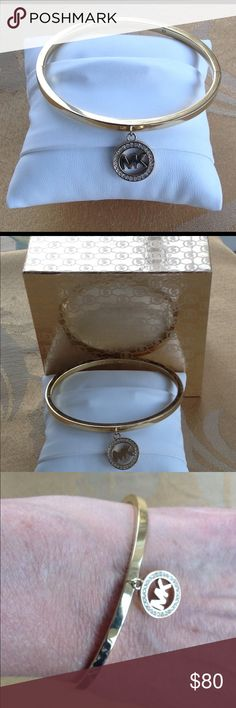 """Michael Kors Rhinestone, Gold tone Bangle Bracelet Pretty Michael Kors gold tone bangle charm bracelet has rhinestone accents.  The bangle measures 2-1/4"""" diameter and will fit a smaller to average wrist. The bracelet will come in the original box with jewelry pillow and pamphlet.  It is in excellent condition.  The bangle opens. Michael Kors Jewelry Bracelets"""