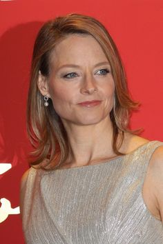 Thin hair can quickly become flat and lifeless, so a flipped-out shaggy bob like the one Jodie Foster wears is a great way to add volume and movement. When styling, flip up the ends in sections with a curling iron. This will create an illusion that you have more hair than you actually do. LOVE THIS HAIRSTYLE .