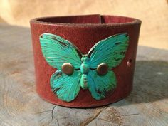 Leather cuff bracelet, handmade from recycled belt, painted metal butterfly
