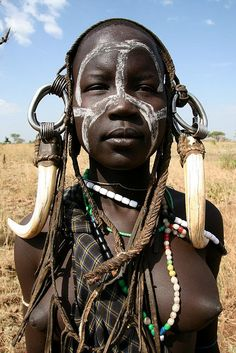 The Mursi tribe are an African tribe from the isolated Omo valley in Southern Ethiopia near the border with Sudan. There are an estimated people in the