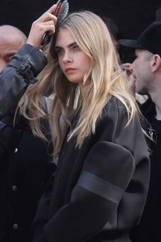 Cara Delevingne. Y'see? Thick, more natural eyebrows are beautiful. Whoever started the awful trend of OVERtweezing should be kicked HARD.