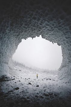 Girl standing in an ice cave
