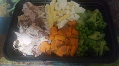 Chicken,sweet potatoes,  broccoli, peas,and a boiled egg.