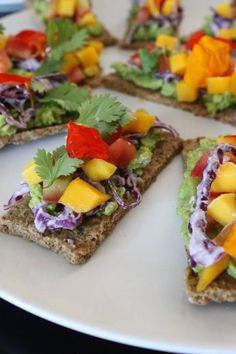 Hawaiian Toast.  Raw Almond Bread.  Avocado.  Purple Cabbage.  Mango Salsa. Herbs.  Edible Flowers. Cashew Cream.