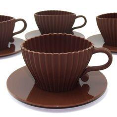 Directo del horno a la mesa: juego de cuatro moldes de silicona con forma de taza, para cupckakes, magdalenas y postres.