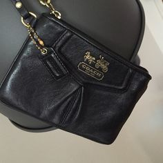 100% authentic Heritage COACH wristlet 100% authentic heritage COACH wristlet. In very good condition - the leather has no hard scratches, lovingly used. The only thing is the slight tarnish on the gold metal hardware from it rubbing against each other. Thanks for looking! Coach Bags Clutches & Wristlets