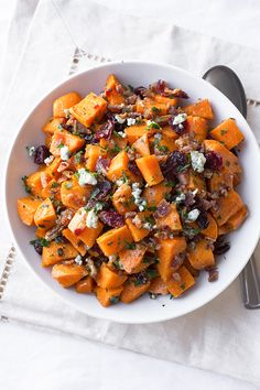 Warm Roasted Sweet Potato Salad with Apple-Smoked Bacon, Blue Cheese, Dried Cranberries and Pecans in Warm Bacon-Herb Vinaigrette | thecozyapron.com