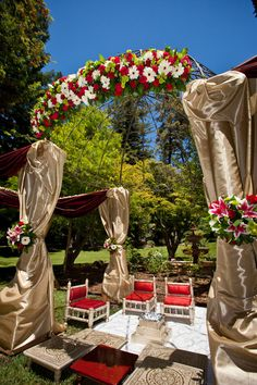Red and gold outdoor mandap on IndianWeddingSite.com