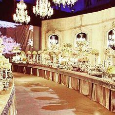 Beautiful buffet area inspired by Chanel's Paris-Bombay 2012 show  Wedding venue : Biel beirut . Wedding planner : Caractere @caractere_events.  Photographer : candid image @candid.image.  Floral decoration : fleurs et couleurs @pamelamansourmehanna.  #blackonmaya @mayarabbataswad.