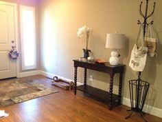 """My foyer so far (12/6/14).  I need to add a mirror on the wall and some baskets or books or """"something"""" on the bottom shelf."""