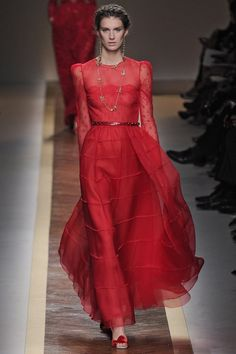 Pin for Later: Try Not to Fall in Love With These Valentino Creations Valentino Spring 2012 The designers were sure to work in Valentino's signature shade of red.