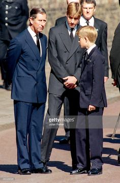 Charles, Prince of Wales, Prince William, and Prince Harry, join the Funeral Procession, at Diana Princess of Wales's Funeral, at St James Palace, for the journey to Westminster Abbey, London, on September 6, 1997, in London, England.