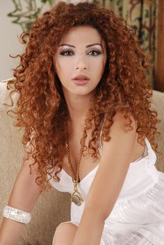 Myriam Fares has the most amazing hair.