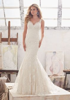 2017 Wedding Dresses and Bridal Gowns by Morilee. This Beautiful Fit & Flare Lace on Net Wedding Dress and Illusion Panels at the Waist.