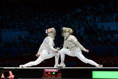 Sophia Velikaya and Olga Kharlan face off in the Olympic semi-finals. Photo: Craig Harkins / Fencing.Net