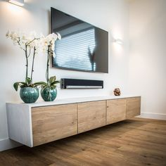 Floating Tv storage unit. Wall mounted media console. Modern TV entertainment unit. Simple contemporary TV wall mount ideas. Contemporary TV console unit. Modern light coloured TV unit. White and wood TV console. #livingroomcontemporary