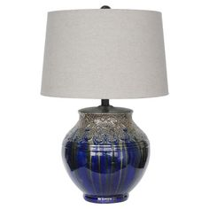 Ceramic table lamp with textured scrolling details and a metallic silver reactive glaze finish.     Product: Table lamp