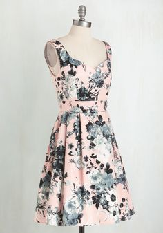 <p>Gussy up in no time flat by simply slipping into this fabulous frock! Boasting a boldly contrasting array of black and white blossoms atop a warm pink backdrop, this pleated, vintage-inspired dress always stands out in a crowd.</p>