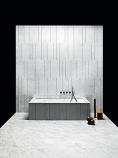 """Completely wrapped in natural stone, the Oyster bathtub could be described as a """"design your own tub"""". With its beautifully simple structure, clean lines and 16 possible combinations of finish, it is the perfect starting point for a total look stone bathroom. Available in Bianco Carrara, Crema d'Orcia, Pietra d'Avola and Silk Georgette® in Honed, Raw, Infinito or Bamboo finishes."""