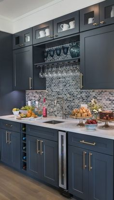 Modern Kitchen Interior Remodeling This seven-bottle wine cooler by Vinotemp inspired us to use this kitchen space as a wet bar. Cool Glass Elegance Mosaic Tile by The Tile Shop. Home Decor Kitchen, Interior Design Kitchen, Kitchen Furniture, New Kitchen, Kitchen Dining, Blue Kitchen Ideas, Apartment Kitchen, Kitchen Colors, Awesome Kitchen