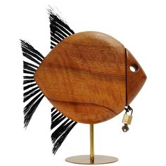 Carl Auböck Walnut Fish Shaped Penny Bank, Austria, 1950 | From a unique collection of antique and modern sculptures at https://www.1stdibs.com/furniture/decorative-objects/sculptures/