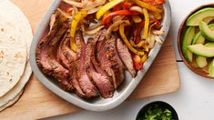 Garlic-Lime Flank Steak Fajitas - Fresh and extra flavorful thanks to steak marinated in lime juice, garlic and Old El Paso™ taco seasoning mix, these easy fajitas, served with grilled peppers and onions, are restaurant quality at just 330 calories. Beef Recipes, Mexican Food Recipes, Dinner Recipes, Cooking Recipes, Mexican Cooking, Grilling Recipes, Steak Fajitas, Steak Marinades, Grilled Peppers And Onions