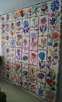 Love the applique.  Wildflowers.