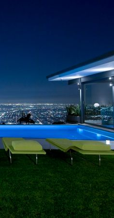 Bliss in the midst of city madness  #pools  via stunning pool overlooking the city lights from Marie Logan