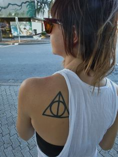 The Deathly Hallows symbol from Harry Potter. I got it not only because I'm a Harry Potter fan but because what it means gives me protection. I got it done by Chris Mack at Eastside Tattoo in New Smyrna Beach, FL.  http://www.deadslutpenland.tumblr.com/