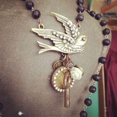 @selinavaughan1s photo: Vintage rosary jewelry - with amusement park tokens at my booth