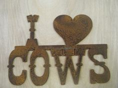 Rusted Rustic Metal I (heart) Cows Sign. $10.00, via Etsy.