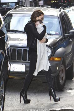 Victoria Beckham with daughter Harper in Victoria Beckham Denim and Louboutin heels. Awesome posh mummy getup, no?