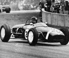 George Harrison taking a 1961 Formula 1 Lotus out for a spin.