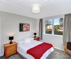 This comfortable Mosgiel property promises to be your forever home Open Plan Kitchen, New Kitchen, Day Room, Painted Walls, Wood Burner, New Carpet, Exterior Paint, Living Area, Floating Shelves