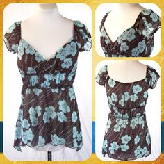 Choco Brown Floral Babydoll Top Size S or 2/4 Cute chiffon babydoll top in baby blue and brown. Floral print with kerchief hem at the hips. Lined across the bust and sheer elsewhere. Size S or 2/4.     **Bundle with Another Item to Get 15% Off Automatically! ** Full Tilt Tops Blouses