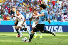 Edinson Cavani of Uruguay shoots and scores his team's first goal on a penalty kick during the 2014 FIFA World Cup Brazil Group D match betw...