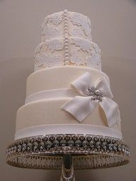 Beautiful pearl and lace wedding cake