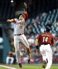 Cincinnati Reds First Baseman Joey Votto (19) Leaps
