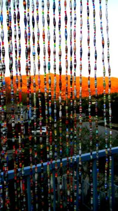 Make a Paper Bead Curtain. A great idea for using those leftover, mismatched paper beads that you aren't quite sure how to ever use.