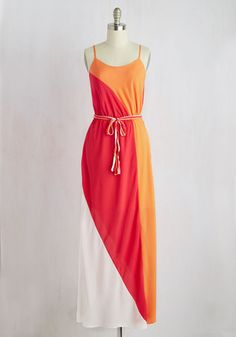Floating through a tasting of Italian treats, you stand out as the sweetest of them all dressed in this vibrant maxi dress! Garnished with bright orange, raspberry, and vanilla colorblocks and topped with a matching, tasseled sash, this flowy dress is a fashionable delicacy.