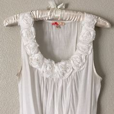 White Rose Tank Delicate white roset tank by Forever 21. Good condition. No trades please. Bundle and save with other items in my closet. Offers are welcome! Forever 21 Tops Tank Tops