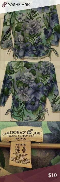 Ladies floral top Floral blouse with three quarter sleeve with a vee neck and strings on the bottom sides. Made with cotton and spandex caribbean joe  Tops Blouses