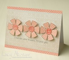 handmade card by Lucy Abrams ... fantasy flowers from polka dot paper with glitter glue centers ... creamy oranges on a pale ecru printed paper  ... sweet finished look ...