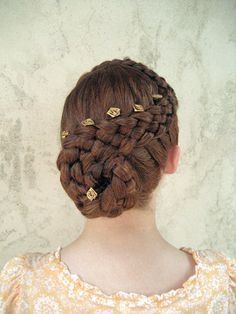 """5 strand diagonal dutch braid swirled into a big bun. I need some practice on 5 strand dutch braiding before attempting to do this hairstyle on my """"models"""""""