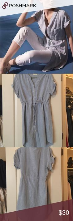 Anthropologie chambray shirt dress Soft linen-type cotton with tie around waist, roll up sleeves, and buttons. Has tiniest marks in front as shown, I will try to get out in the wash. This dress is marked as a large but fits a little snug for a large. Anthropologie Dresses Mini
