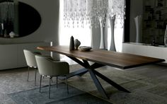 modern dining table design by Cattelan Italia aesthetic sculptural table