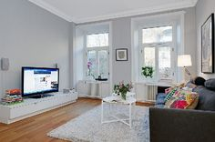 I love the contrast of the light grey walls and white trim. Simple and bright.