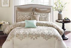 Revamp your master bedroom with this array of accents and cozy linens. Pair pleated curtain panels with an upholstered bench or storage ottoman for an elegant look, and then make your bed the focal point with a tufted headboard, printed comforter set, and throw pillows.
